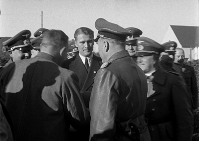 Wernher von Braun with General Emil Leeb, head of Army Weapons Office, and Fritz Todt, Minister of Armaments and Munitions, and Other German Army Officers at Peenemünde. Courtesy of Wikimedia Commons.