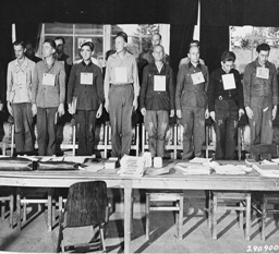 Defendants at Dora War Crimes Trial, beginning 7 August 1947 at Former Dachau Concentration Camp. Courtesy of Wikimedia Commons.